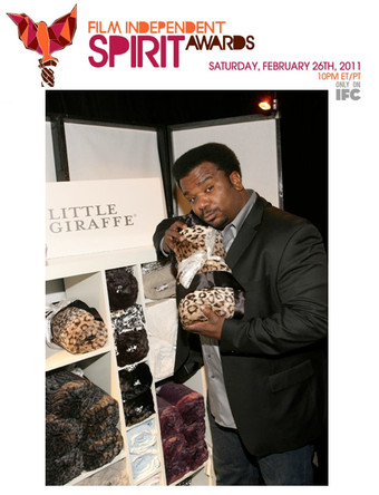 Craig Robinson with Little Giraffe