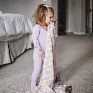 Hearts galore with our Luxe Heart Army Baby Blanket in Dusty Pink. Photo by @micaelajprince