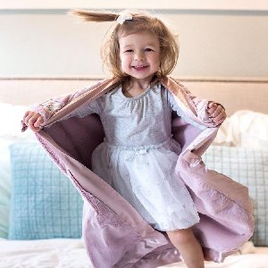 All smiles when you have your favorite blanket wrapped around you!