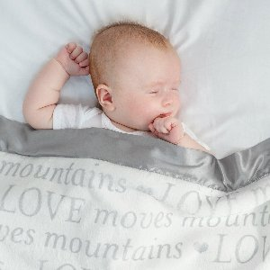 Our classic Luxe, in a print worth sharing. Shop our new Luxe LOVE Moves Mountains Baby Blanket in Silver or Dusty Pink!