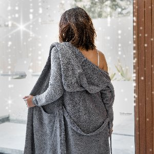 Stay cozy all year long in our Dolce Hoodie Cover Up!