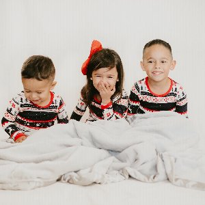 The best gift around the tree: family.  Photo by @briannamuniz_ featuring her cuties wrapped up in our Luxe Throw in Silver.