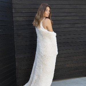 There's no place like home.  Especially when bundled up in our silky-soft Luxe Knit Throw!