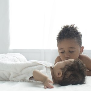 Naptime isn't complete without our silky-soft Stretch Chenille Dreamsack and kisses from a big brother.