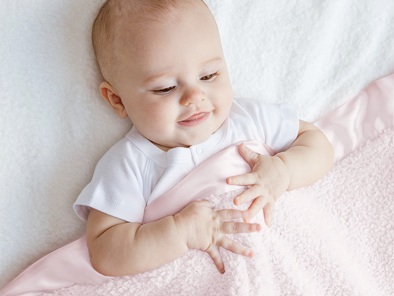 Baby with pink Chenille blanket